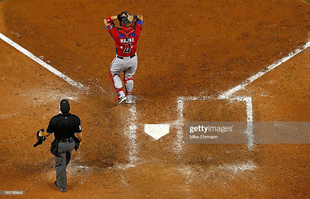 Yadier Molina #4 of Puerto Rico reacts to winning a World Baseball Classic second round game against the United States at Marlins Park on March 15, 2013 in Miami, Florida.