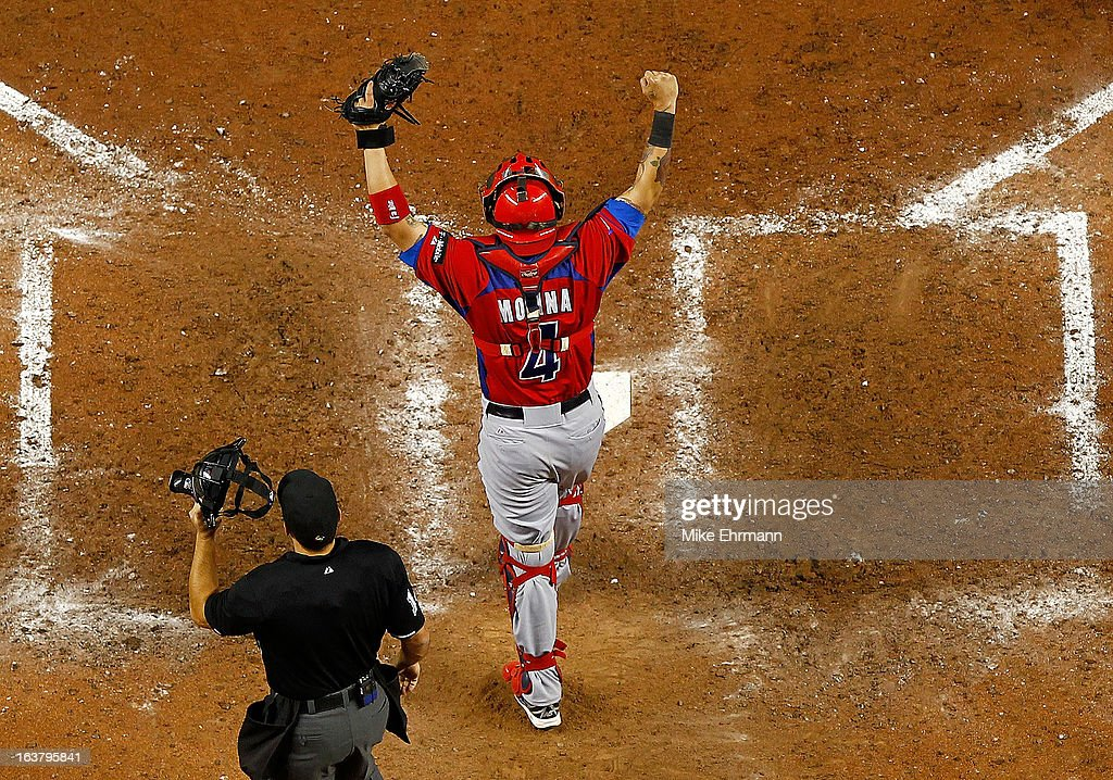<a gi-track='captionPersonalityLinkClicked' href=/galleries/search?phrase=Yadier+Molina&family=editorial&specificpeople=172002 ng-click='$event.stopPropagation()'>Yadier Molina</a> #4 of Puerto Rico reacts to winning a World Baseball Classic second round game against the United States at Marlins Park on March 15, 2013 in Miami, Florida.