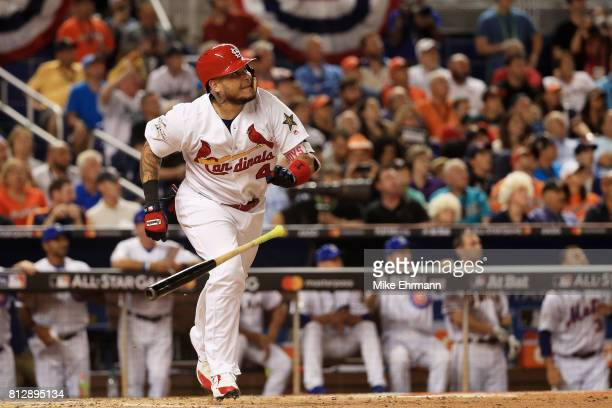 Yadier Molina of the St Louis Cardinals and the National League reacts after hitting a solo home run in the sixth inning against the American League...