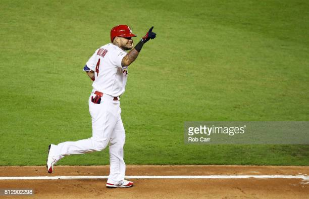 Yadier Molina of the St Louis Cardinals and the National League celebrates after hitting a solo home run in the sixth inning against the American...