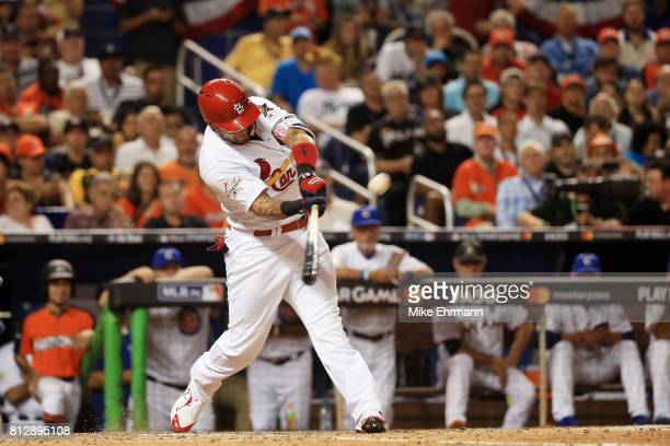 Yadier Molina of the St Louis Cardinals and the National League hits a solo home run in the sixth inning against the American League during the 88th...