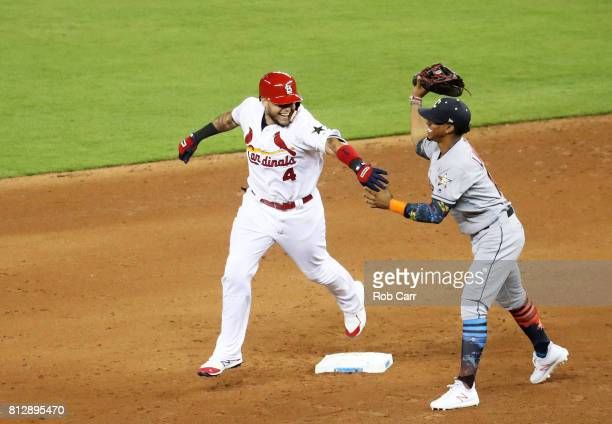 Yadier Molina of the St Louis Cardinals and the National League jokes with Francisco Lindor of the Cleveland Indians and the American League as he...