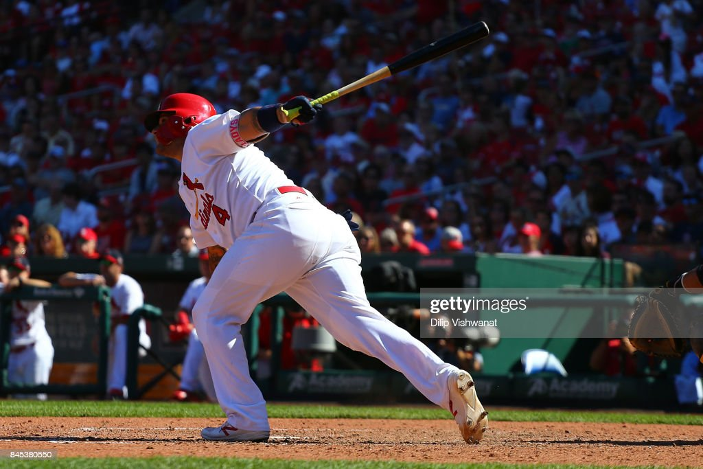 Yadier Molina #4 of the St. Louis Cardinals bats in a run with a sacrifice fly against the Pittsburgh Pirates in the seventh inning at Busch Stadium on September 10, 2017 in St. Louis, Missouri.