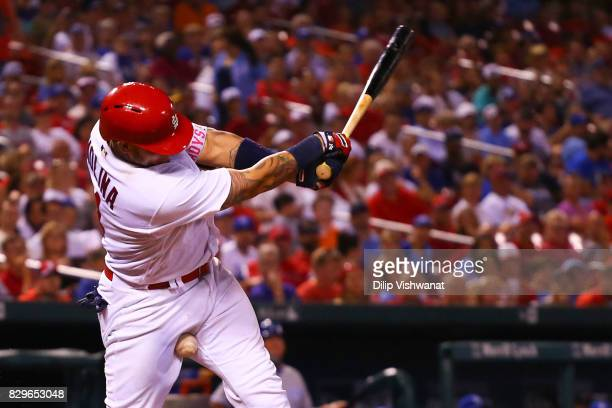 Yadier Molina of the St Louis Cardinals bounces a foul tip into himself during an atbat against the Kansas City Royals in the eighth inning at Busch...