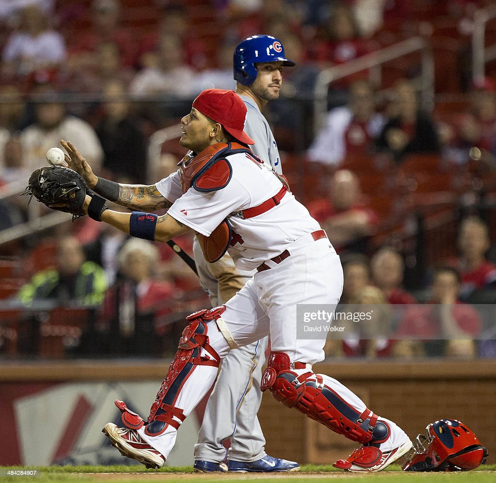 Yadier Molina #4 of the St. Louis Cardinals catches a pop fly in the eleventh inning during a game against the Chicago Cubs at Busch Stadium on April 11, 2014 in St. Louis, Missouri.