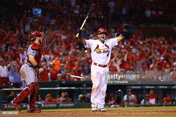 Yadier Molina of the St Louis Cardinals celebrates after being hit by a pitch to drive in the gamewinning run against the Cincinnati Reds in the...