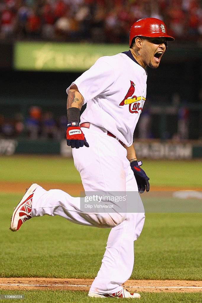 Yadier Molina of the St Louis Cardinals celebrates after hitting a tworun home run off of starter Edwin Jackson of the Chicago Cubs in the sixth...