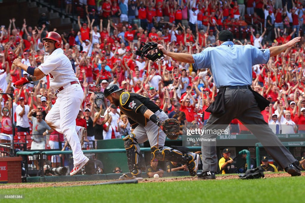 <a gi-track='captionPersonalityLinkClicked' href=/galleries/search?phrase=Yadier+Molina&family=editorial&specificpeople=172002 ng-click='$event.stopPropagation()'>Yadier Molina</a> #4 of the St. Louis Cardinals celebrates after scoring the game-winning run against <a gi-track='captionPersonalityLinkClicked' href=/galleries/search?phrase=Russell+Martin+-+Baseball+Player&family=editorial&specificpeople=13764024 ng-click='$event.stopPropagation()'>Russell Martin</a> #55 of the Pittsburgh Pirates in the ninth inning at Busch Stadium on September 3, 2014 in St. Louis, Missouri. The Cardinals beat the Pirates 1-0 with a walk-off single.