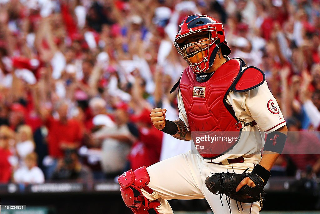 <a gi-track='captionPersonalityLinkClicked' href=/galleries/search?phrase=Yadier+Molina&family=editorial&specificpeople=172002 ng-click='$event.stopPropagation()'>Yadier Molina</a> #4 of the St. Louis Cardinals celebrates after the final out against the Los Angeles Dodgers during Game Two of the National League Championship Series at Busch Stadium on October 12, 2013 in St Louis, Missouri. The St. Louis Cardinals defeated the Los Angeles Dodgers 1 to 0.
