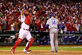 Yadier Molina of the St Louis Cardinals celebrates as Mark Ellis of the Los Angeles Dodgers strikes out as the Cardinals defeat the Los Angeles...