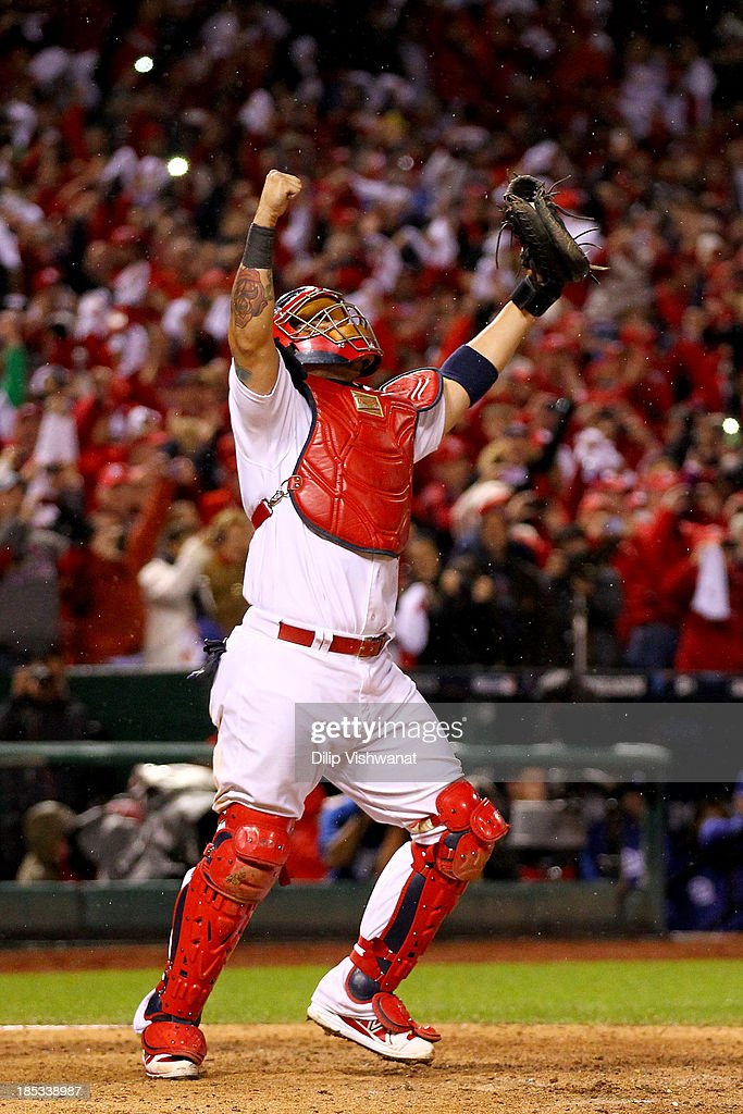 Yadier Molina #4 of the St. Louis Cardinals celebrates as Mark Ellis #14 of the Los Angeles Dodgers strikes out as the Cardinals defeat the Los Angeles Dodgers 9-0 in Game Six of the National League Championship Series at Busch Stadium on October 18, 2013 in St Louis, Missouri.