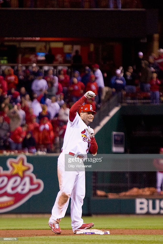 Yadier Molina #4 of the St. Louis Cardinals celebrates celebrates hitting the game-winning RBI against the Atlanta Braves at Busch Stadium on April 26, 2010 in St. Louis, Missouri. The Cardinals beat the Braves 4-3.