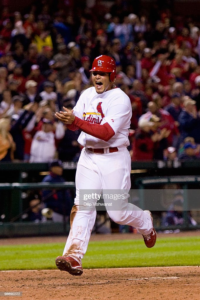 Yadier Molina #4 of the St. Louis Cardinals celebrates scoring the game-tying RBI against the Atlanta Braves at Busch Stadium on April 26, 2010 in St. Louis, Missouri. The Cardinals beat the Braves 4-3.