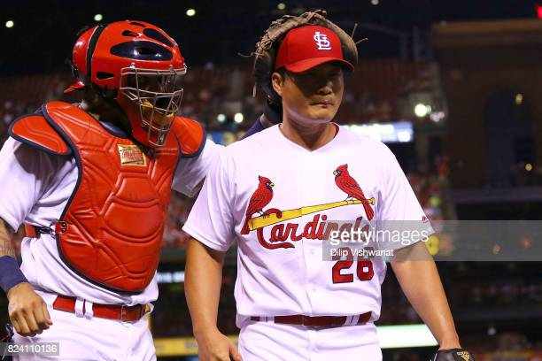 Yadier Molina of the St Louis Cardinals congratulates SeungHwan Oh of the St Louis Cardinals after Ho pitched out of a runscoring situation against...