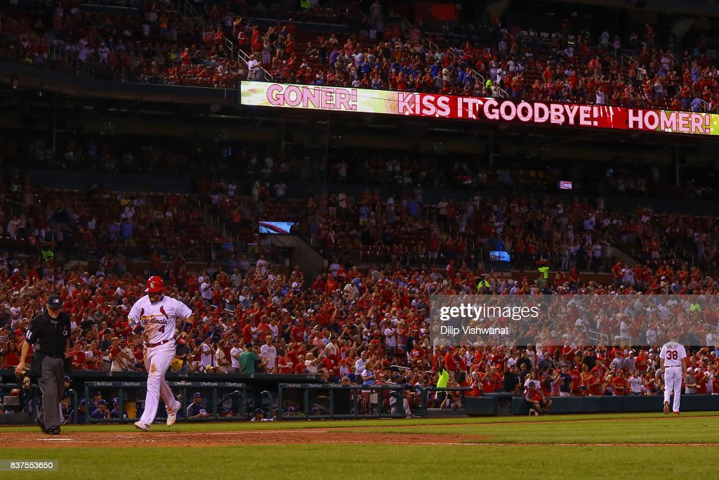 Yadier Molina #4 of the St. Louis Cardinals crosses home plate after hitting a home run against the San Diego Padres in the sixth inning at Busch Stadium on August 22, 2017 in St. Louis, Missouri.
