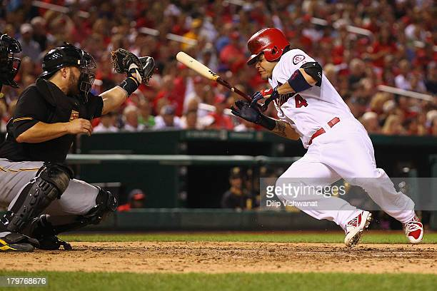 Yadier Molina of the St Louis Cardinals dodges a highinside pitch against the Pittsburgh Pirates in the seventh inning at Busch Stadium on September...