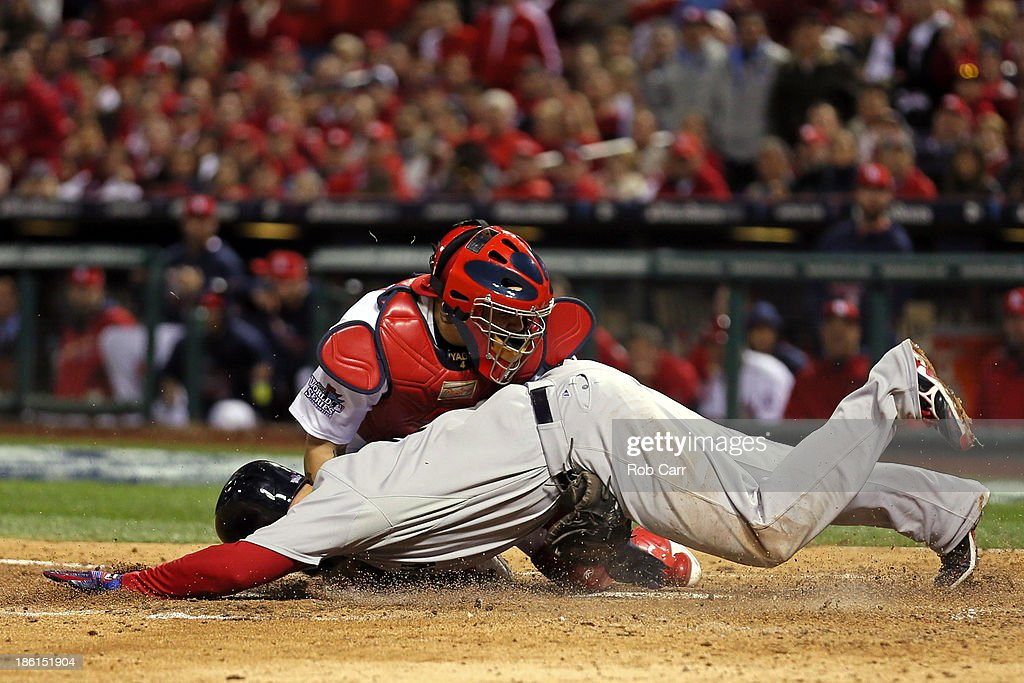 <a gi-track='captionPersonalityLinkClicked' href=/galleries/search?phrase=Yadier+Molina&family=editorial&specificpeople=172002 ng-click='$event.stopPropagation()'>Yadier Molina</a> #4 of the St. Louis Cardinals gets the out on <a gi-track='captionPersonalityLinkClicked' href=/galleries/search?phrase=David+Ross+-+Baseball+Player&family=editorial&specificpeople=210843 ng-click='$event.stopPropagation()'>David Ross</a> #3 of the Boston Red Sox at home plate in the seventh inning during Game Five of the 2013 World Series at Busch Stadium on October 28, 2013 in St Louis, Missouri.