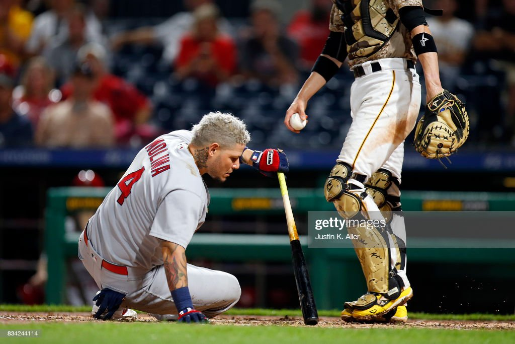 Yadier Molina #4 of the St. Louis Cardinals gets up after nearly being hit by a pitch in the seventh inning against the Pittsburgh Pirates at PNC Park on August 17, 2017 in Pittsburgh, Pennsylvania.