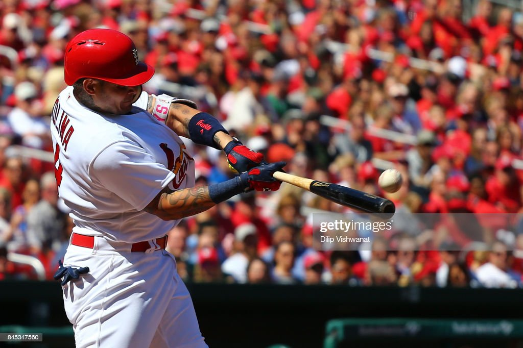 Yadier Molina #4 of the St. Louis Cardinals hits a three-run home run against the Pittsburgh Pirates in the third inning at Busch Stadium on September 10, 2017 in St. Louis, Missouri.