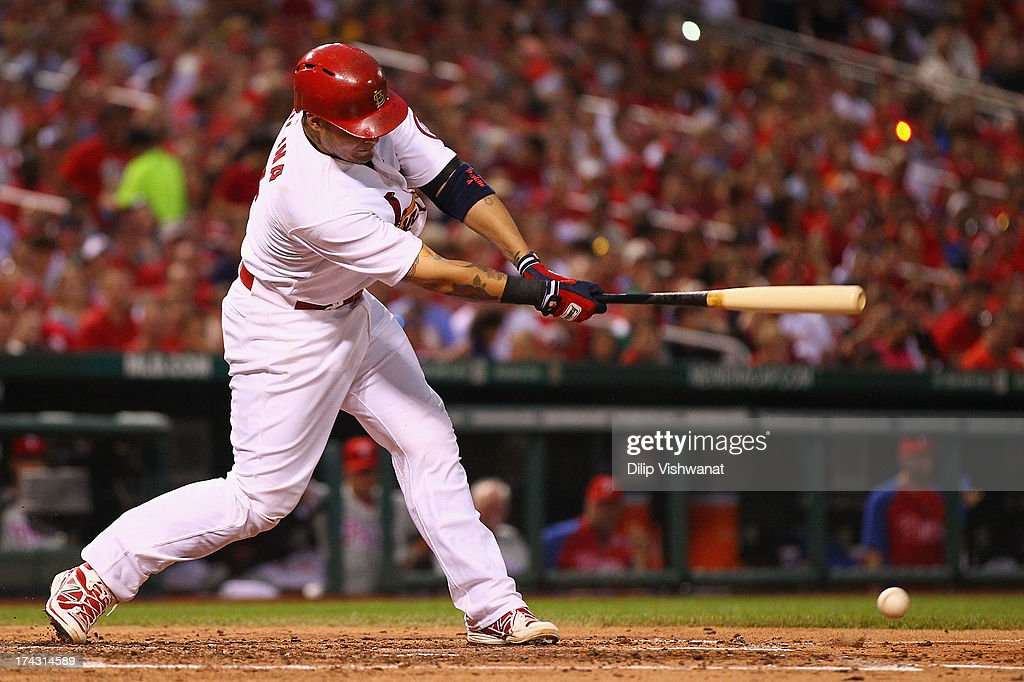 <a gi-track='captionPersonalityLinkClicked' href=/galleries/search?phrase=Yadier+Molina&family=editorial&specificpeople=172002 ng-click='$event.stopPropagation()'>Yadier Molina</a> #4 of the St. Louis Cardinals hits an RBI double against the Philadelphia Phillies in the fourth inning at Busch Stadium on July 23, 2013 in St. Louis, Missouri.