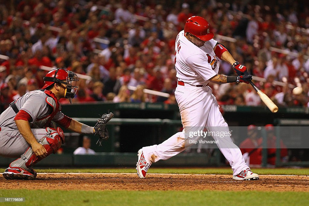 <a gi-track='captionPersonalityLinkClicked' href=/galleries/search?phrase=Yadier+Molina&family=editorial&specificpeople=172002 ng-click='$event.stopPropagation()'>Yadier Molina</a> #4 of the St. Louis Cardinals hits an RBI double off of <a gi-track='captionPersonalityLinkClicked' href=/galleries/search?phrase=Jonathan+Broxton&family=editorial&specificpeople=551385 ng-click='$event.stopPropagation()'>Jonathan Broxton</a> #51 of the Cincinnati Reds in the eighth inning at Busch Stadium on April 29, 2013 in St. Louis, Missouri. The Reds beat the Cardinals 2-1.