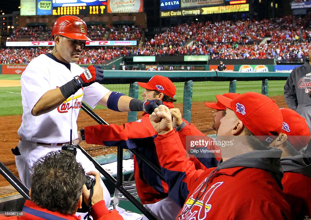 <a gi-track='captionPersonalityLinkClicked' href=/galleries/search?phrase=Yadier+Molina&family=editorial&specificpeople=172002 ng-click='$event.stopPropagation()'>Yadier Molina</a> #4 of the St. Louis Cardinals is congratulated after scoring in the seventh inning against the San Francisco Giants in Game Four of the National League Championship Series at Busch Stadium on October 18, 2012 in St Louis, Missouri.