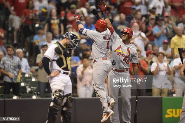 Yadier Molina of the St Louis Cardinals is congratulated by Jose Martinez following a solo home run during the sixth inning against the Milwaukee...