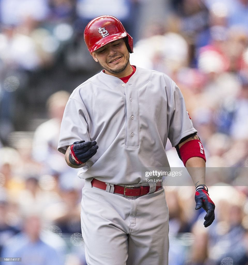 <a gi-track='captionPersonalityLinkClicked' href=/galleries/search?phrase=Yadier+Molina&family=editorial&specificpeople=172002 ng-click='$event.stopPropagation()'>Yadier Molina</a> #4 of the St Louis Cardinals is hit with a pitch by Alfredo Figaro #45 of the Milwaukee Brewers in the sixth inning at Miller Park on May 5, 2013 in Milwaukee, Wisconsin.