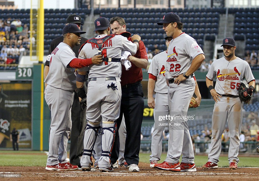<a gi-track='captionPersonalityLinkClicked' href=/galleries/search?phrase=Yadier+Molina&family=editorial&specificpeople=172002 ng-click='$event.stopPropagation()'>Yadier Molina</a> #4 of the St. Louis Cardinals is tended to by medical staff after a collistion at home in the second inning against the Pittsburgh Pirates during the game on August 28, 2012 at PNC Park in Pittsburgh, Pennsylvania.