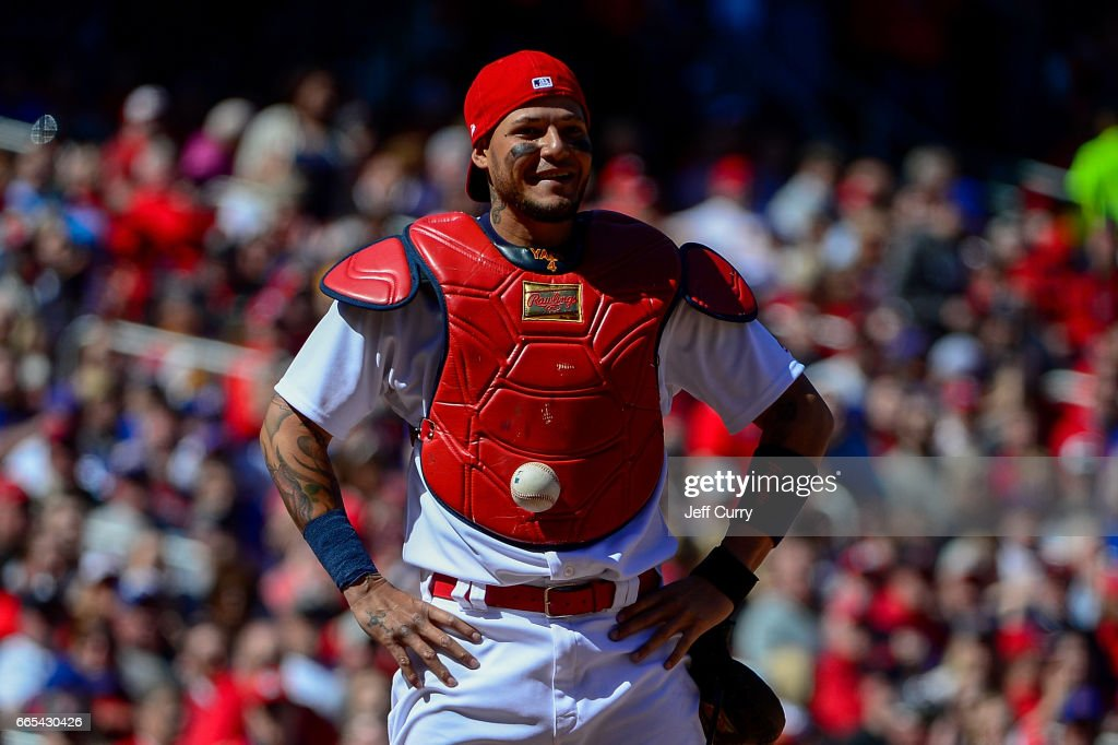 Yadier Molina #4 of the St. Louis Cardinals looks on after the ball got stuck to his chest protector allowing Matt Szczur #20 of the Chicago Cubs to advance to first after a swinging third strike during the seventh inning at Busch Stadium on April 6, 2017 in St Louis, Missouri.