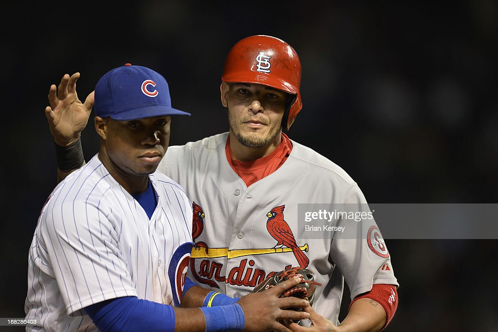 <a gi-track='captionPersonalityLinkClicked' href=/galleries/search?phrase=Yadier+Molina&family=editorial&specificpeople=172002 ng-click='$event.stopPropagation()'>Yadier Molina</a> #4 of the St. Louis Cardinals (R) pats third baseman Luis Valbuena #24 of the Chicago Cubs on the head after he was caught stealing during the eighth inning on May 7, 2013 at Wrigley Field in Chicago, Illinois.