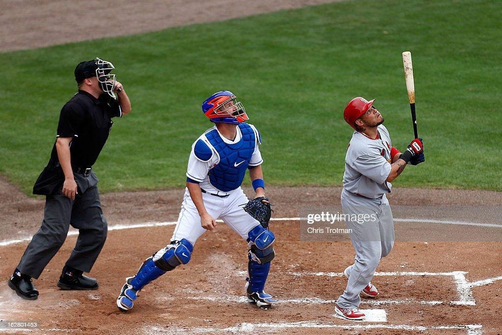<a gi-track='captionPersonalityLinkClicked' href=/galleries/search?phrase=Yadier+Molina&family=editorial&specificpeople=172002 ng-click='$event.stopPropagation()'>Yadier Molina</a> #4 of the St. Louis Cardinals pops the ball up as <a gi-track='captionPersonalityLinkClicked' href=/galleries/search?phrase=John+Buck&family=editorial&specificpeople=213730 ng-click='$event.stopPropagation()'>John Buck</a> #44 of the New York Mets looks on at Tradition Field on February 27, 2013 in Port St. Lucie, Florida.
