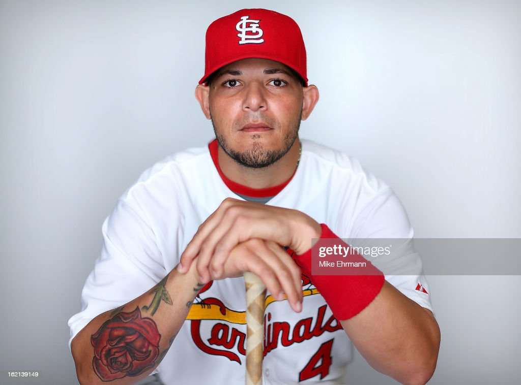 <a gi-track='captionPersonalityLinkClicked' href=/galleries/search?phrase=Yadier+Molina&family=editorial&specificpeople=172002 ng-click='$event.stopPropagation()'>Yadier Molina</a> #4 of the St. Louis Cardinals poses during photo day at Roger Dean Stadium on February 19, 2013 in Jupiter, Florida.