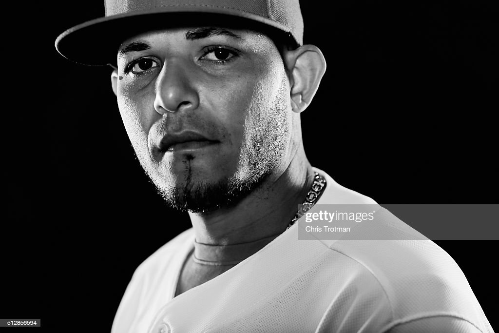 Yadier Molina #4 of the St. Louis Cardinals poses for a photograph at Spring Training photo day at Roger Dean Stadium on February 25, 2016 in Jupiter, Florida.