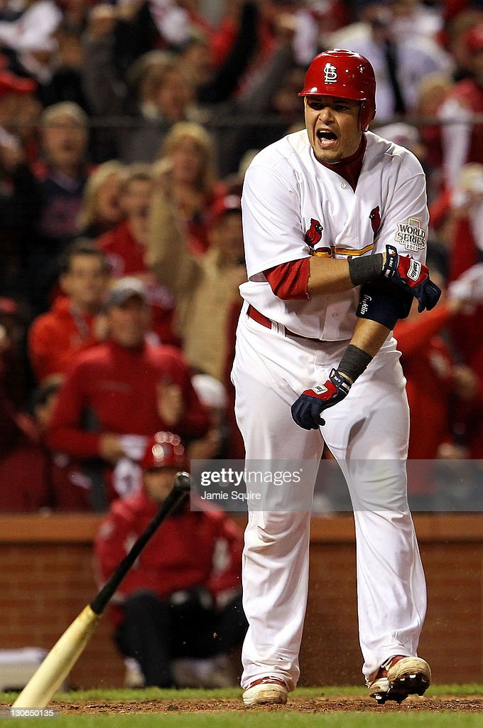 <a gi-track='captionPersonalityLinkClicked' href=/galleries/search?phrase=Yadier+Molina&family=editorial&specificpeople=172002 ng-click='$event.stopPropagation()'>Yadier Molina</a> #4 of the St. Louis Cardinals reacts after drawing a walk with the bases loaded to score Lance Berkman #12 in the sixth inning during Game Six of the MLB World Series against the Texas Rangers at Busch Stadium on October 27, 2011 in St Louis, Missouri.