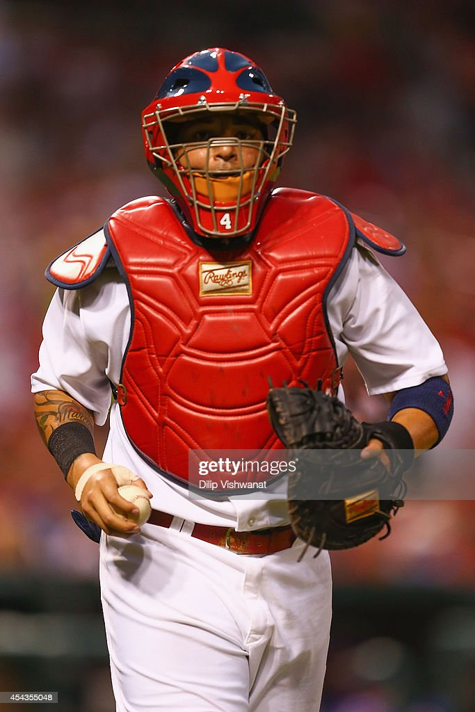 <a gi-track='captionPersonalityLinkClicked' href=/galleries/search?phrase=Yadier+Molina&family=editorial&specificpeople=172002 ng-click='$event.stopPropagation()'>Yadier Molina</a> #4 of the St. Louis Cardinals returns to the dugout, in the first inning, after catching his first inning since retuning form the disabled list against the Chicago Cubs at Busch Stadium on August 29, 2014 in St. Louis, Missouri.