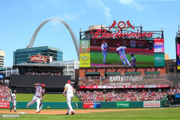 Yadier Molina of the St Louis Cardinals rounds third base after hitting a tworun home run against the Chicago Cubs in the second inning at Busch...