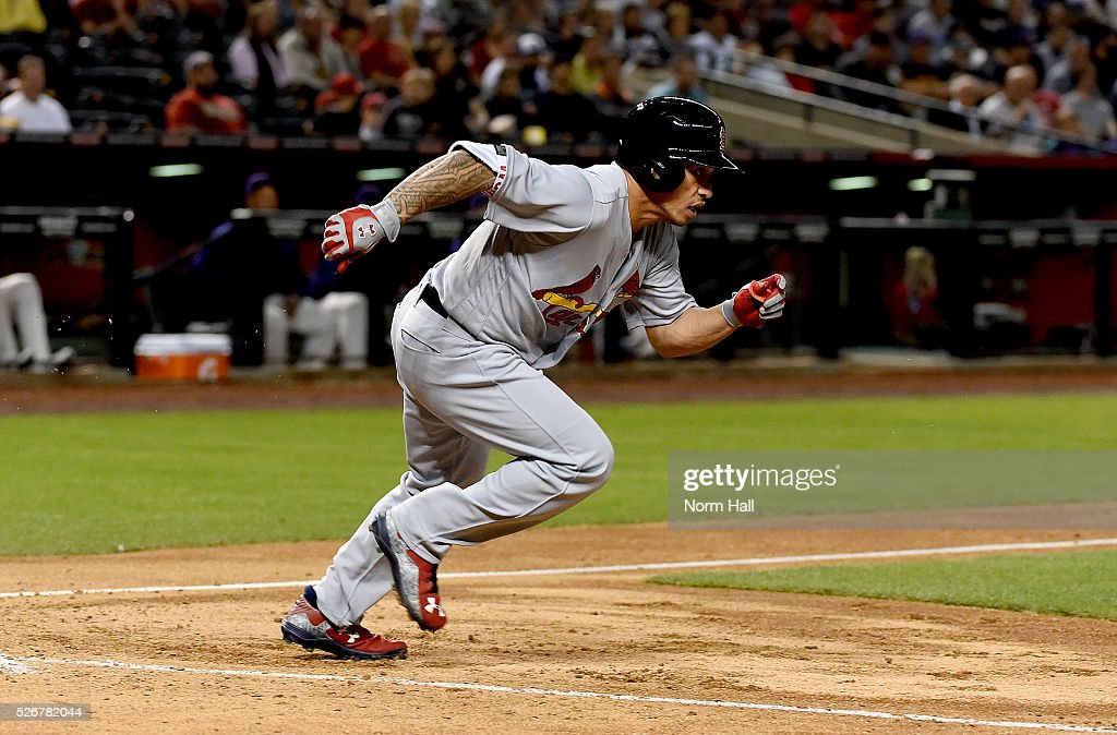 <a gi-track='captionPersonalityLinkClicked' href=/galleries/search?phrase=Yadier+Molina&family=editorial&specificpeople=172002 ng-click='$event.stopPropagation()'>Yadier Molina</a> #4 of the St Louis Cardinals runs out of the batters box to first base against the Arizona Diamondbacks on April 28, 2016 in Phoenix, Arizona.