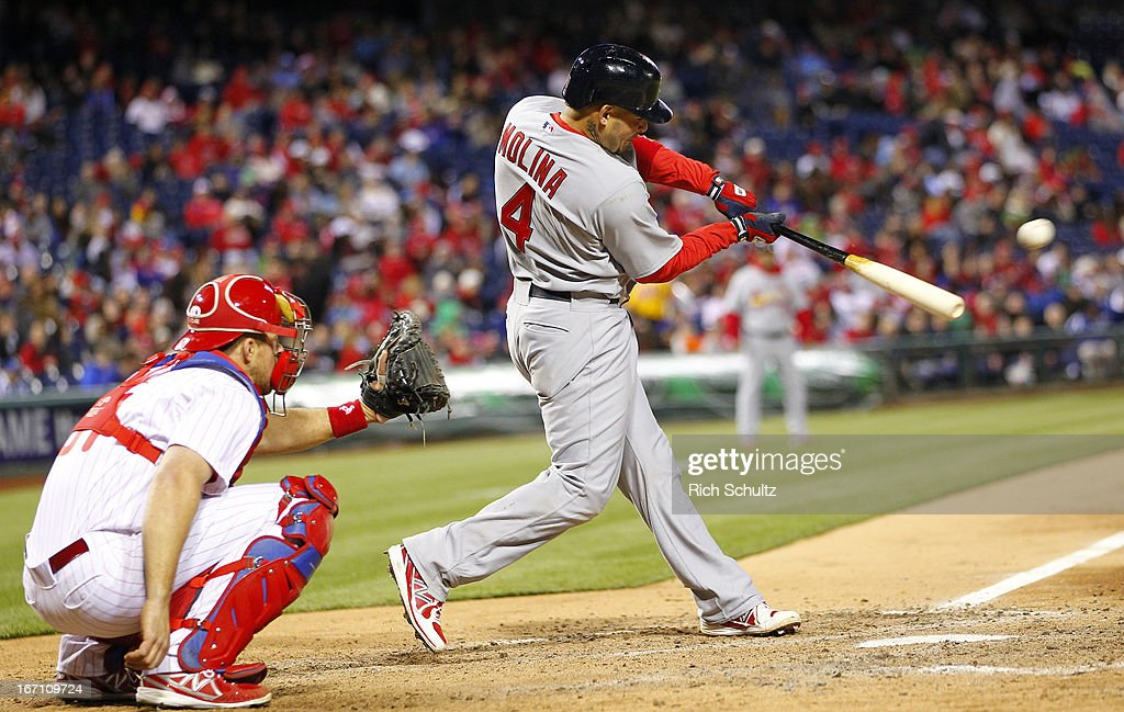 <a gi-track='captionPersonalityLinkClicked' href=/galleries/search?phrase=Yadier+Molina&family=editorial&specificpeople=172002 ng-click='$event.stopPropagation()'>Yadier Molina</a> #4 of the St. Louis Cardinals singles in the eighth inning against the Philadelphia Phillies in a MLB baseball game on April 20, 2013 at Citizens Bank Park in Philadelphia, Pennsylvania. The Cardinals defeated the Phillies 5-0.