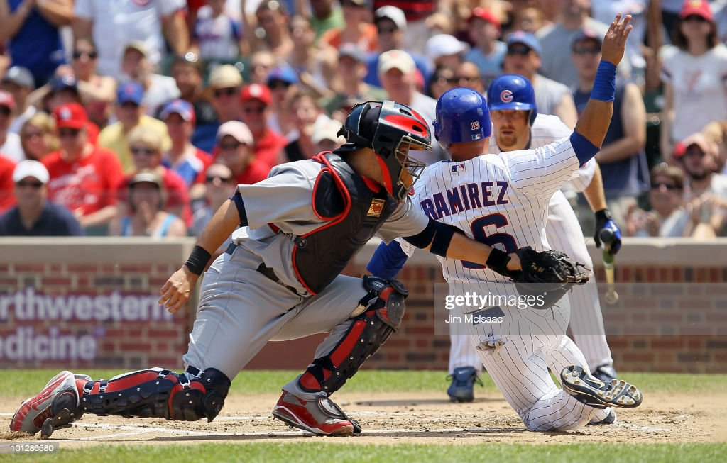 Yadier Molina of the St Louis Cardinals tags out Aramis Ramirez of the Chicago Cubs for the final out of the second inning on May 30 2010 at Wrigley...