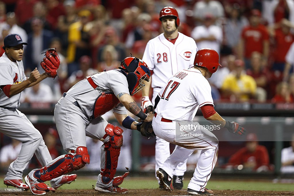 <a gi-track='captionPersonalityLinkClicked' href=/galleries/search?phrase=Yadier+Molina&family=editorial&specificpeople=172002 ng-click='$event.stopPropagation()'>Yadier Molina</a> #4 of the St. Louis Cardinals tags out <a gi-track='captionPersonalityLinkClicked' href=/galleries/search?phrase=Shin-Soo+Choo&family=editorial&specificpeople=196543 ng-click='$event.stopPropagation()'>Shin-Soo Choo</a> #17 of the Cincinnati Reds after being caught in a rundown between third and home at Great American Ball Park on September 4, 2013 in Cincinnati, Ohio. The Cardinals won 5-4 in 16 innings.