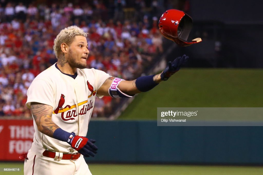 Yadier Molina #4 of the St. Louis Cardinals tosses his helmet in frustration after lining out against the Boston Red Sox in the third inning at Busch Stadium on May 16, 2017 in St. Louis, Missouri.
