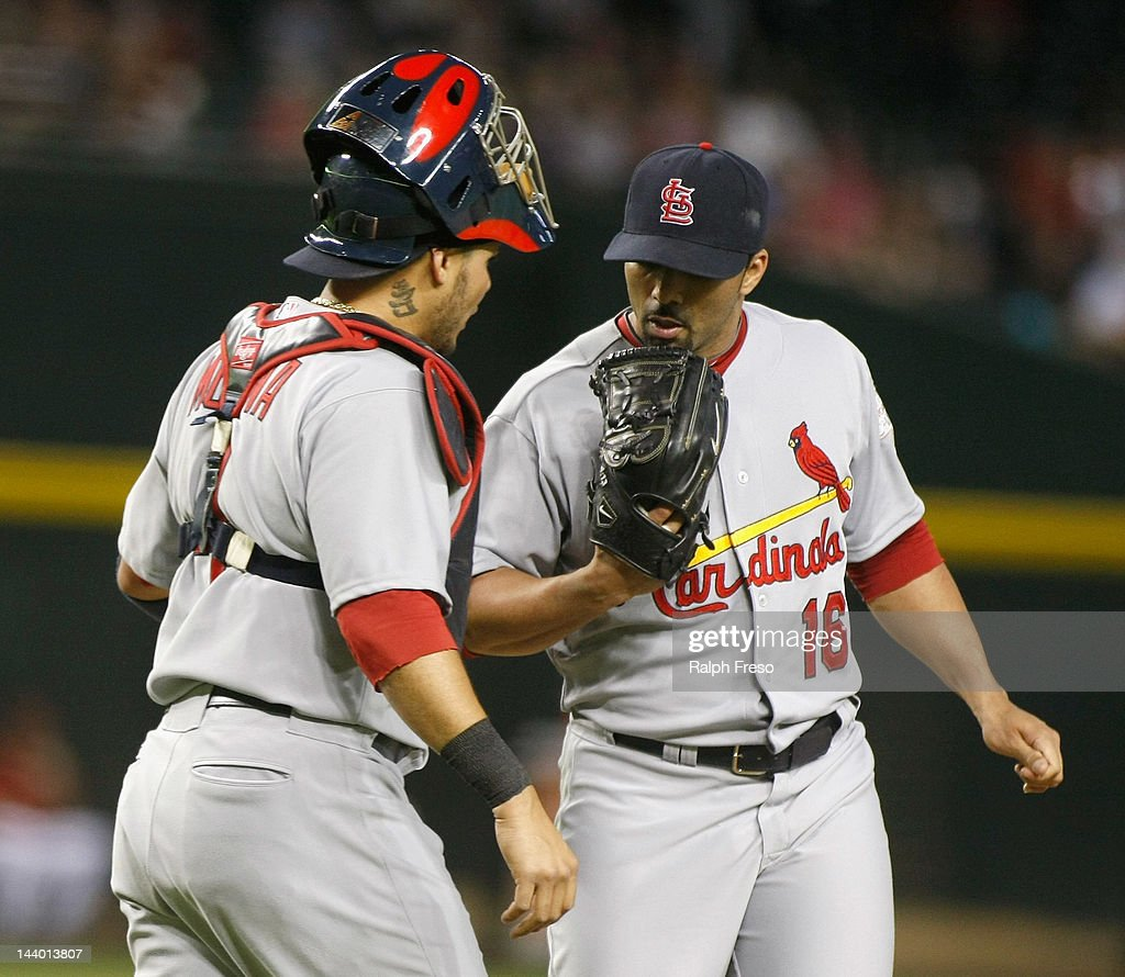 Yadier Molina of the St Louis Cardinals visits the mound to talk with pitcher JC Romero after the Arizona Diamondbacks score four runs during the...