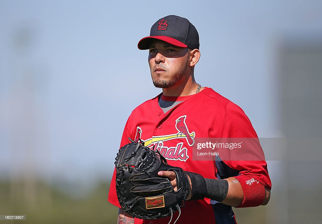 <a gi-track='captionPersonalityLinkClicked' href=/galleries/search?phrase=Yadier+Molina&family=editorial&specificpeople=172002 ng-click='$event.stopPropagation()'>Yadier Molina</a> #4 of the St. Louis Cardinals warms up prior to the start of spring training on February 20, 2013 in Jupiter, Florida.