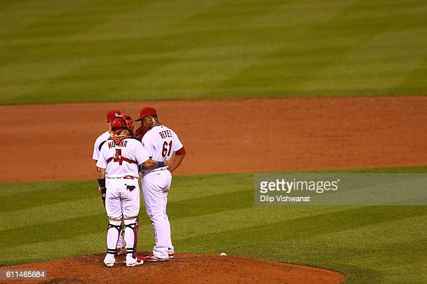 Yadier Molina talks to starter Alex Reyes of the St Louis Cardinals during a Cincinnati Reds at bat in the sixth inning at Busch Stadium on September...