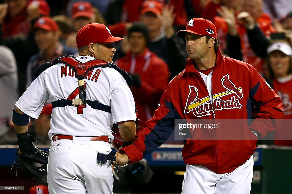 <a gi-track='captionPersonalityLinkClicked' href=/galleries/search?phrase=Yadier+Molina&family=editorial&specificpeople=172002 ng-click='$event.stopPropagation()'>Yadier Molina</a> #4 talks with manager <a gi-track='captionPersonalityLinkClicked' href=/galleries/search?phrase=Mike+Matheny&family=editorial&specificpeople=171706 ng-click='$event.stopPropagation()'>Mike Matheny</a> #22 of the St. Louis Cardinals after Molina catches a foul ball to end the eighth inning against the San Francisco Giants in Game Three of the National League Championship Series at Busch Stadium on October 17, 2012 in St Louis, Missouri.