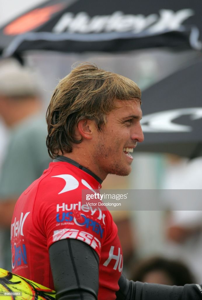 Yadin Nicol walks back to the competitor's area after Heat 3 of the Men's Round of 24 during the 2009 Hurley US Open of Surfing on July 24 2009 in...