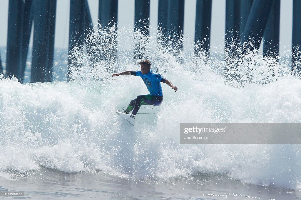 Yadin Nicols of Australia hops over the foam during the final heat against Kelly Slater of USA at the Nike US Open of Surfing on August 7 2011 in...
