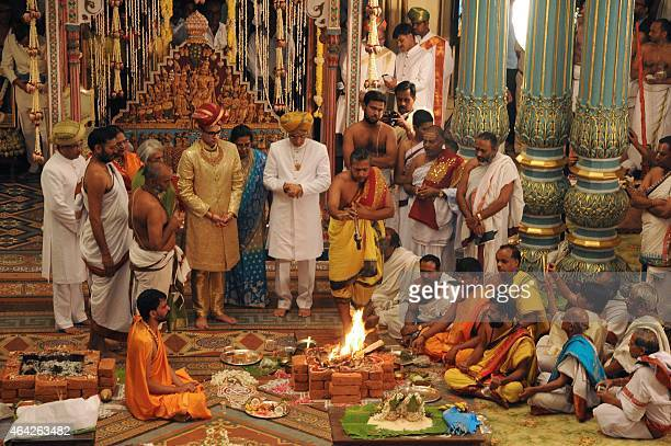 Yaduveer Gopal Raj Urs stands next to his grandmother princess Gayathri Devi as royal priests perform the traditional ritual for his adoption as the...