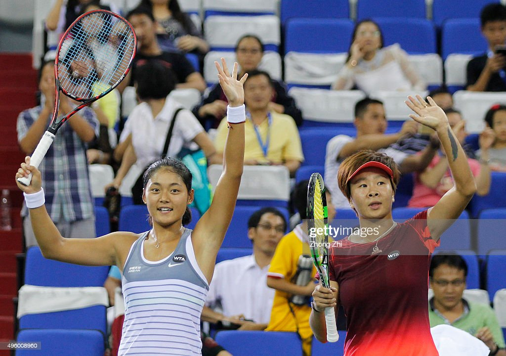 Yafan Wang of China and Chen Liang react after winning the doubles match against Lyudmyla Kichenok of Ukraine and Nadiia Kichenok of Ukraine on day 5...